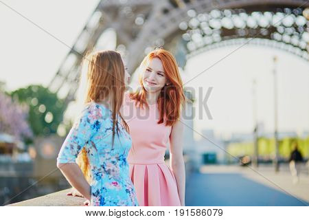 Two Friends Near The Eiffel Tower In Paris, France