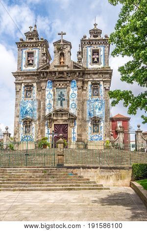 PORTO,PORTUGAL - MAY 13,2017 - View at the church of Saint Ildefonso with azulejo decorated facade in Porto. Porto is located along the Douro river estuary in Northern Portugal.