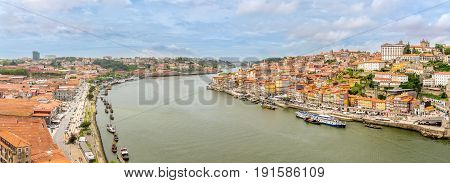 PORTO,PORTUGAL - MAY 13,2017 - Panoramic view at the embankment of Douro River in Porto. Porto is located along the Douro river estuary in Northern Portugal.