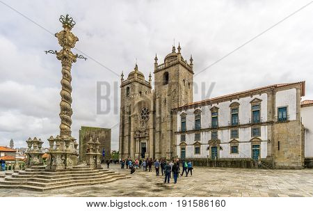PORTO,PORTUGAL - MAY 13,2017 - View at the Cathedral of Porto with pillory. Porto is one of the oldest European centres and its historical core was proclaimed a World Heritage Site by UNESCO in 1996.