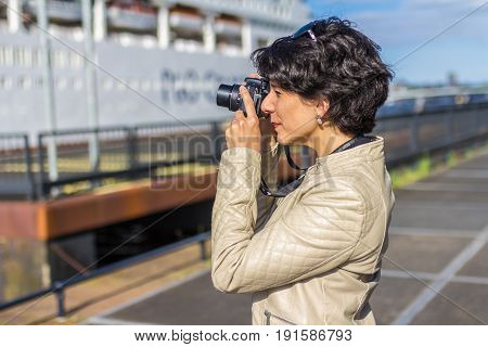 Amsterdam the Netherlands - May 31 2017: woman taking photos of P&O Aurora cruise ship in Amsterdam