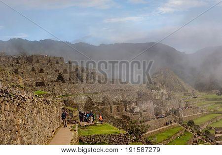 Macchu Picchu, Peru- March 15, 2017: Morning mist rising above Macchu Pichu Valley Peru