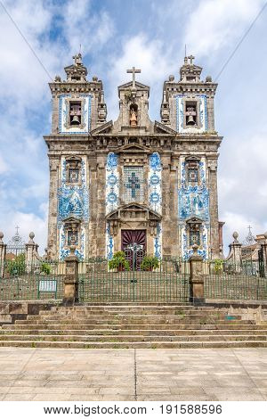 View at the azulejo decorated facade of church Saint Ildefonso in Porto - Portugal