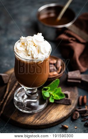 Iced cocoa drink with whipped cream cold chocolate beverage coffee frappe on dark background
