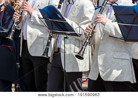 Orchestra Musicians Playing Clarinets During City Music Fest