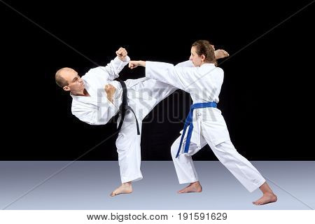 Block and punch arm man and woman are trainining