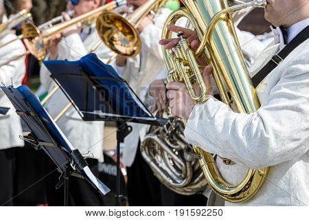 Musicians Are Playing On Trumpets During Outdoor Concert Of Classical Music