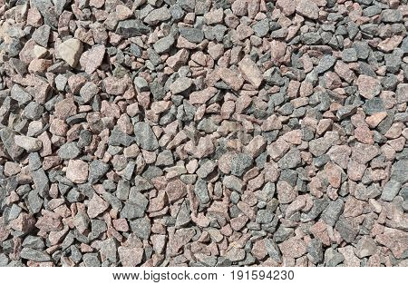Sunny day. Crushed stone on the construction site. Color white gray brown yellow red