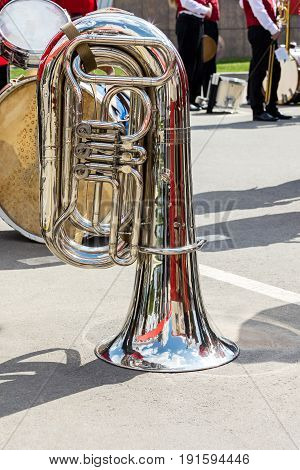 Big Bass Tuba On Pavement Background During The Break Of Orchestra Performance. Music Instruments Cl