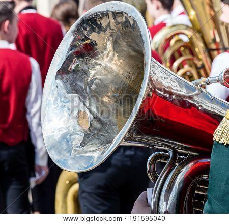 Bright Big Brass Bass Tuba On Defocused Orchestra Background