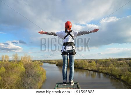 Rope jumping from high altitude of bridge on beautiful river.