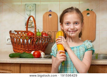 child girl with big cabbage, vegetables and fresh fruits in kitchen interior, healthy food concept