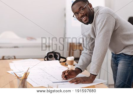 Interesting project. Positive handsome nice mean leaning over the table and drawing a scheme while looking at you