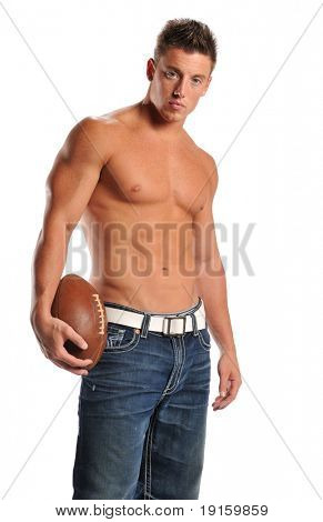 Muscular man holding a football isolated on a white background