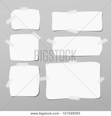 Note, notebook, copybook paper, stuck with white sticky tape on grey background