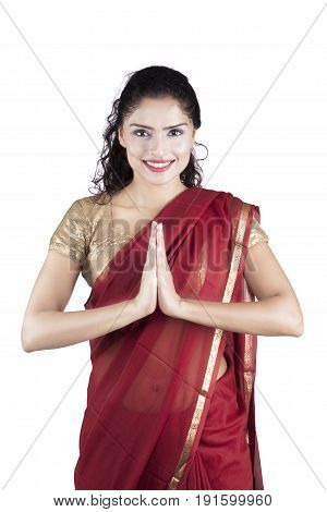 Portrait of indian woman smiling at the camera with welcoming pose isolated on white background