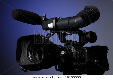 Professional video camera on a blue background poster
