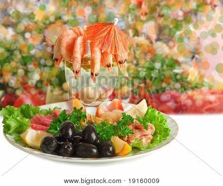 Appetizer of shrimp fish meats olives and fresh vegetables poster