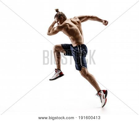 Attractive man runner in silhouette. Photo of shirtless muscular male isolated on white background. Dynamic movement. Side view
