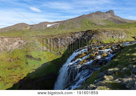 Iceland Landscape With Small Waterfall Among Green Hills. Beautiful Scenery In Saefellsnes Peninsula