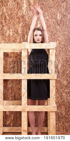 Woman posing in fashion style posing on wooden wall in studio photo. Style and vogue
