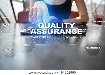 Quality assurance concept on the virtual screen. Business concept