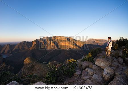 Blyde River Canyon, Travel Destination In South Africa. Tourist Looking At Panorama. Last Sunlight O