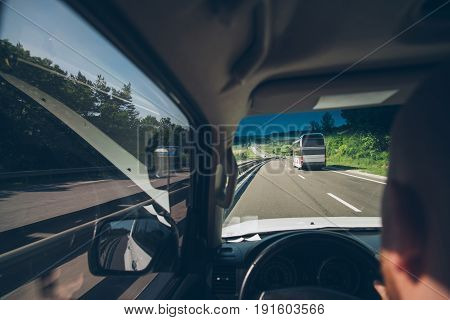 man driving on highway in sunny day bus forehead