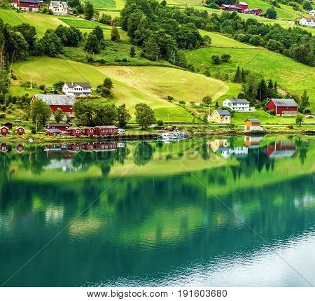 Natural landscape, Scandinavia. Olden in Norwegian fjords. Tourist camping on the beach.