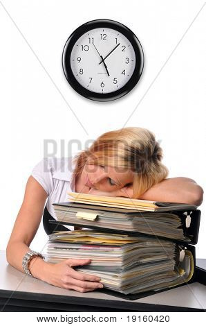 Woman at the office sleeping over a pile of files