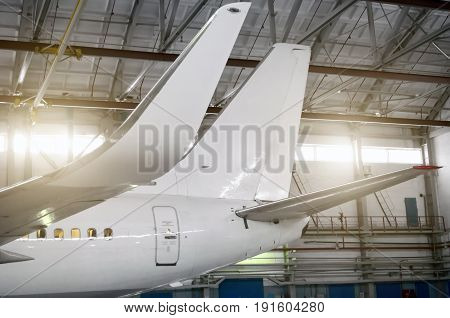 Airplane In The Hangar, View Of The Wings And Tail.