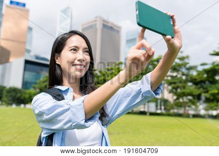 Woman travel in Hong Kong and taking selfie