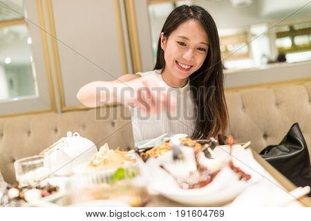 Woman having dinner in chinese resturant