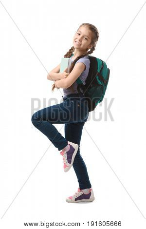 Cute funny girl with schoolbag and book on white background