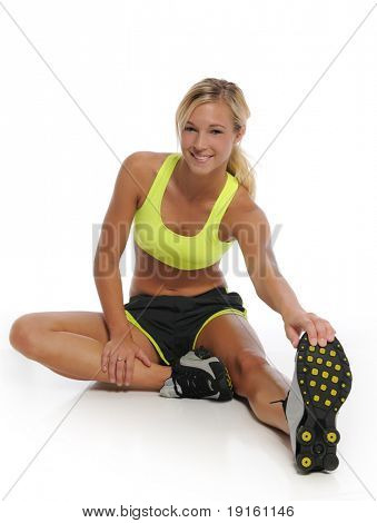 Young woman working out and stretching isolated on a white background