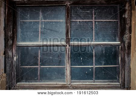 Dirty window in the old house shed