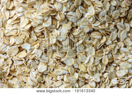 Oatmeal flakes on a plate close up