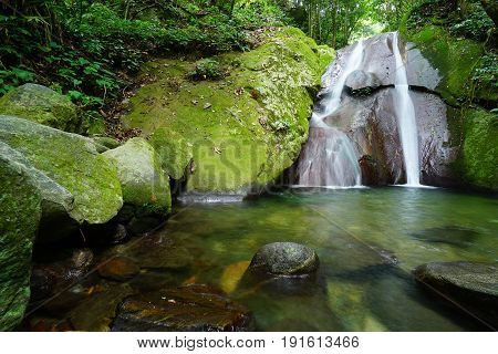 Long Exposure Image of Kipungit waterfall in Poring Hot Spring, Kota Kinabalu National Park located in Sabah Borneo, Malaysia.