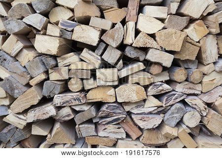 A lot of chopped firewood, stacked and ready for winter.