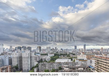 KUNMING CHINA - JUN 28: Cityscape and building in downtown Kunming China on June 28 2015. Kunming is capital of Yunnan province most famous city of southwest china.