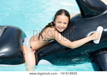 beautiful pretty young girl in pool with squall buoys