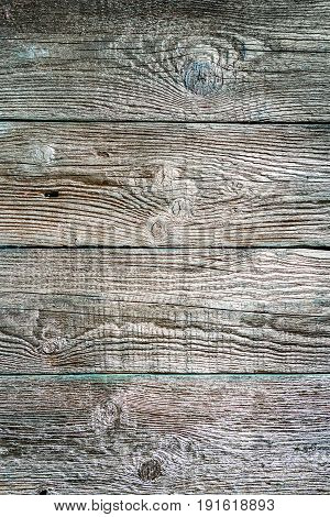Texture of wooden unpainted aged horizontal boards