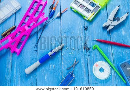 Fishing Accessories And Tools On A Decorative Background. Turquoise Background.