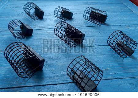 The Composition Of The Fishing Feeders. Decorative Background. Fishing Accessories.