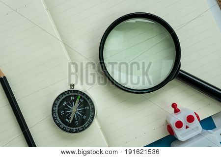 SEO search engine optimization website analysis concept with pencil compass robot and magnifying glass.