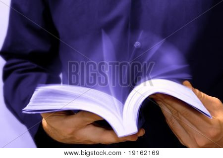 Fast learning concept: businessman reading a book