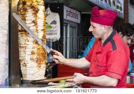ISTANBUL, TURKEY - 4 APRIL , 2017:Man cooks Turkish meat kebab at a street cafe