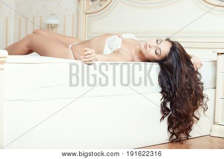 Attractive lady lying and sleeping in bedroom