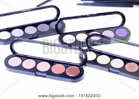 Close-up photo of the makeup set on textured white background