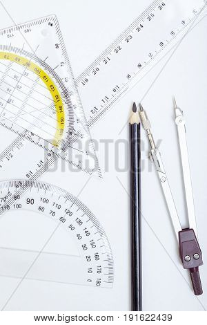 Drawing tools on a paper. Close-up photo